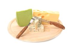 Various types of cheeses on wood. With knife. Royalty Free Stock Images