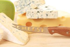 Various types of cheeses on wood. Royalty Free Stock Image