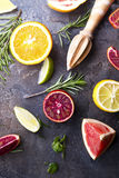 Various types of citrus fruit. On a dark stone background Stock Photos
