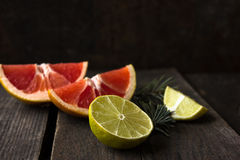 Various types of citrus fruit on a wooden background Royalty Free Stock Images