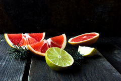 Various types of citrus fruit on a wooden background Stock Image