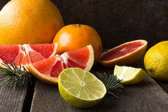 Various types of citrus fruit on a wooden background Royalty Free Stock Image