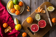 Various types of citrus fruit on a wooden background Stock Photo