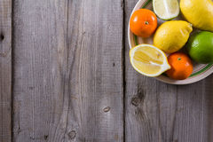 Various types of citrus fruit on a wooden background. Classic Still Life Royalty Free Stock Images