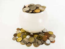 Various types of coins in a ceramic pot. Coins in a ceramic pot as financial concepts royalty free stock images