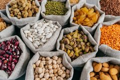 Various types of dried fruit and cereals at farmers market. Mung bean, almond, mulberry, garbanzo, raisins. Close up shot royalty free stock photos