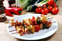 Various types of fish with shrimp on skewers Stock Photos