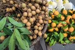 Various types of fruits selling from the traditional hanging baskets stock photography
