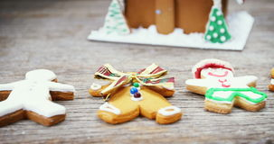 Various types of gingerbread. On a wooden plank during christmas time 4k stock video footage