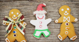 Various types of gingerbread. On a wooden plank during christmas time 4k stock footage