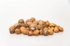 Various types of healthy nuts. Walnuts, Almonds, Brazil nuts, hazel nuts stock photos