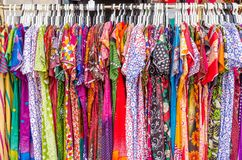 Various types of Indian fashion clothes displaying and selling stock images