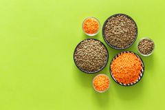 Various types of lentils on a green background with space for text. Various types of lentil on a green background with space for text lentils assimilable stock images