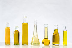 Various types of oil in bottles Stock Photos