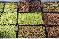 Olives bulk. Various types of olives in bulk store sale royalty free stock photos