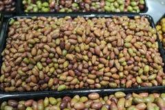 Olives bulk. Various types of olives in bulk store sale royalty free stock image