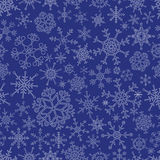 Various types of outline white snowflakes seamless blue pattern eps10 Royalty Free Stock Image