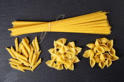 Various types of pasta on black background, from above Stock Images