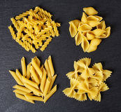 Various types of pasta on black background, from above Royalty Free Stock Photos