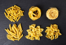 Various types of pasta on black background, from above Stock Image