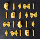 Various types of pasta on black background, from above Stock Photo