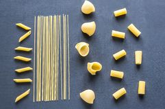 Various types of pasta on the dark background Stock Photo