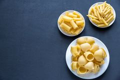 Various types of pasta on the dark background Royalty Free Stock Photography