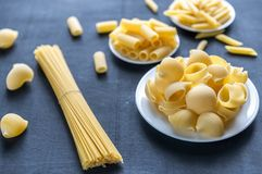 Various types of pasta on the dark background Royalty Free Stock Photo