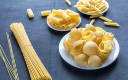 Various types of pasta on the dark background Stock Photo