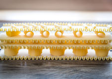 Various types of pasta on lasagne sheets Stock Image