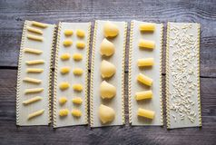 Various types of pasta on lasagne sheets Stock Images