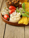 Various types of pasta (spaghetti, fettuccini, penne) Stock Image