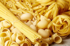 Various types of pasta on stone table Royalty Free Stock Image
