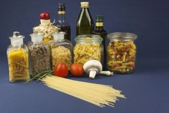 Various types of pasta on the table. Homemade food preparation stock photos