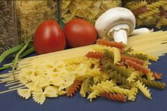 Various types of pasta on the table. Homemade food preparation royalty free stock images