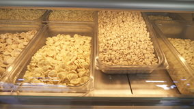Various types of pasta typical of Apulia. Shooting of the machine for the production of pasta stock video