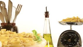 Various types of pasta. On a white background stock video