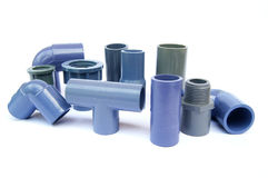 Various types of pipe fittings. In a white background Stock Photography