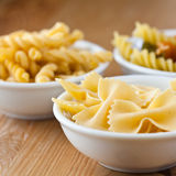 Various types of raw pasta Stock Photography