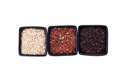 Various types of rice. Various types of non-white rice in black bowls isolated on white Stock Image