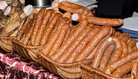 Various types of sausages in baskets Royalty Free Stock Images