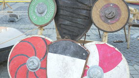 Various Types of Shields. Various types of medieval war shields, resting on a war camp stock footage