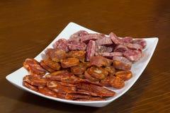 Various types of spanish salami, sausage and ham. Royalty Free Stock Images