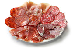 Various types of  spanish salami, sausage and ham. Royalty Free Stock Photography