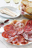 Various types of  spanish salami, sausage and ham. Royalty Free Stock Photos