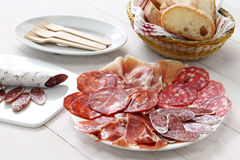 Various types of  spanish salami, sausage and ham. Stock Photos