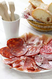 Various types of  spanish salami, sausage and ham. Royalty Free Stock Image