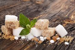 Various types of sugar. Various types of sugar - brown, white, crystal, cane and artificial sweetener on nwooden table royalty free stock images