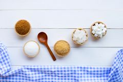 Various types of sugar on wooden. Background royalty free stock photo