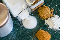Various Types of Sugars. Various types of sugar, including coconut, powdered, brown and granulated sugars. Sugar containers included on a kitchen counter stock photography